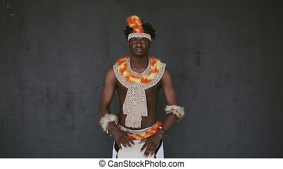 African Man Playing Drum