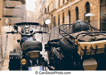 Old vintage motorcycle with a sidecar for a passenger