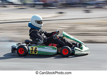Karting - driver in helmet on kart circuit - Karting -...