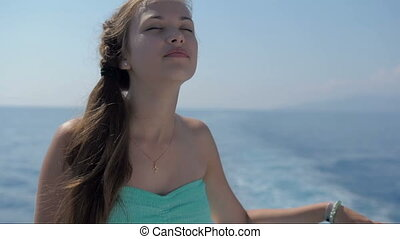 Beautiful young girl on the deck of a ship HD