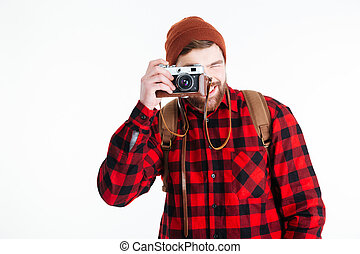 Happy casual man making photo on camera isolated on a white...