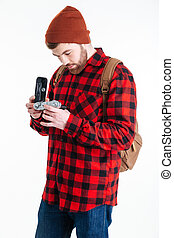 Male hipster opening retro camera isolated on a white...
