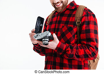 Cropped image of a man holding retro camera - Cropped image