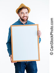Close-up portrait of a smiling man holding blank board -...
