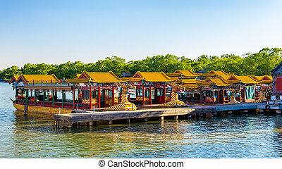 Traditional Chinese boats on Kunming Lake at the Summer...
