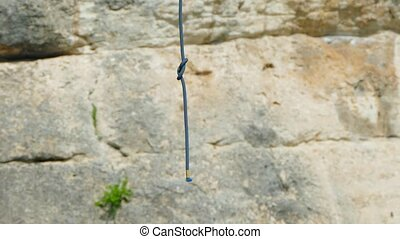 Climbing Rope Hanging In Air - Climbing rope with knot...