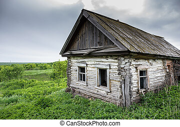 Dilapidated old village house in Russia - Dilapidated old...