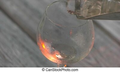 Ice cubes slowly fall Scoop fills wineglass with ice...