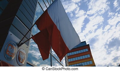 Waving Polish Flags on Building on Blue Sky with Clouds at...