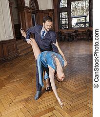 Dancer Bending Backwards While Supported By Partner - Full...