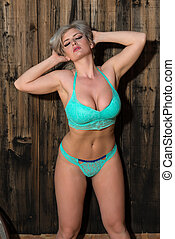 Blonde in teal - Beautiful statuesque blonde dressed in teal...