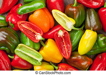 Fresh colorful bell peppers on wooden table Top view