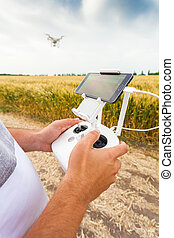 Unmanned copter Man controls quadrocopter flight -...
