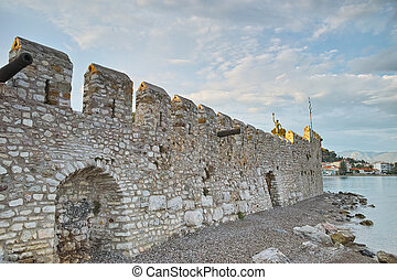 Sunset at the port of Nafpaktos - Castle wall at the port of...