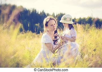 Daughter gives mother flowers.