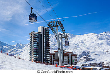 Ski lift. Ski resort Val Thorens. Village of Les Menuires....