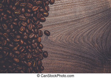 coffee beans on the brown wooden table - roasted coffee...