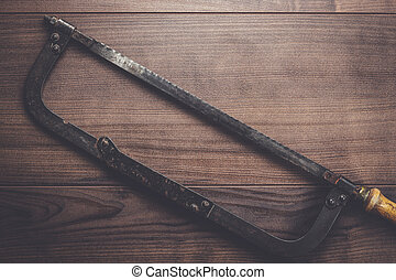 old hacksaw rusty on wooden background - old hacksaw rusty...