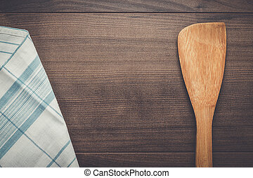 wooden spatula on the brown table background