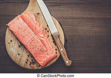 salted trout on the hardboard and knife
