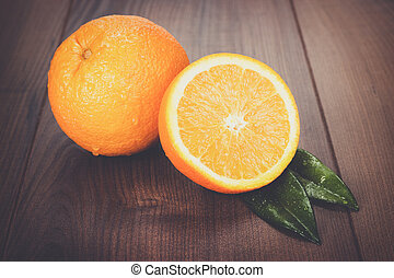 fresh oranges on brown wooden table - fresh oranges on the...