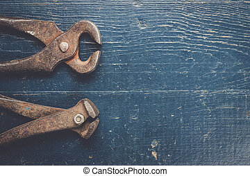 old rusty tongs on blue table - old rusty tongs on blue...