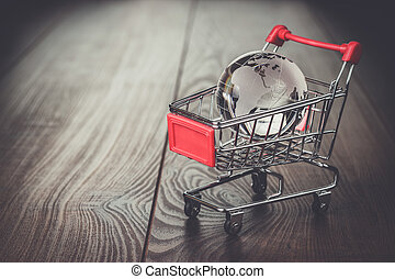 glass globe in the shopping trolley concept - glass globe in...