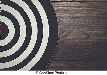 darts target on dark wooden background - darts target on the...