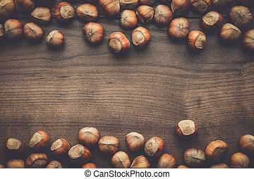 hazelnuts on the brown wooden table background