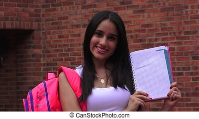 Teenage Female High School Student With Notebook