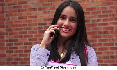 Happy Female Student Talking On Cell Phone