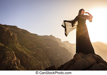 Omani woman in the mountains - Lone woman in abaya in Al...