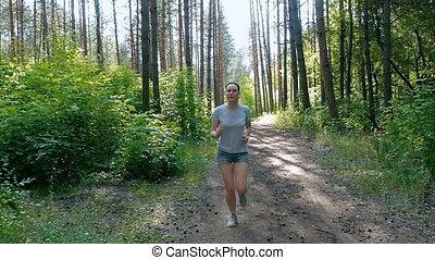 Runner woman running in park