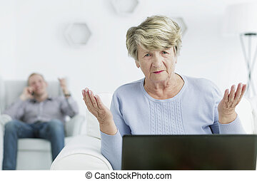 How does it work - Sad elderly woman sitting in front of a...