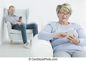 Life is much easier with a smartphone - Happy senior woman...