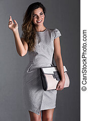 Look like a million dollars - Young woman holding a large...