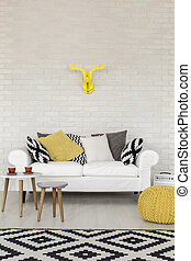 Decorate with yellow - Shot of a sofa in a modern creative...