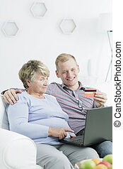 Online shopping with a grandson - Elderly woman using...