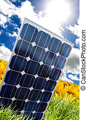 Solar panel and sunray - Solar panel in a yellow field of...