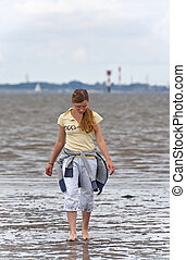 Girl in the Mudflat - This image shows a walking girl in the...