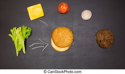 Building a Burger. Stop motion animation - Top view of...