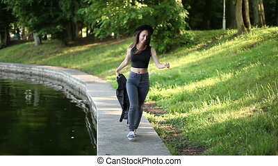 Girl walking in the park. summer