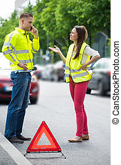 Couple Using Mobile Phone With Broken Down Car - Young...