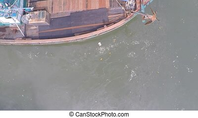 Fishing vessels in dirty water, aerial view from above
