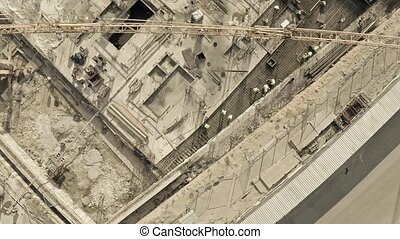 Aerial view of cranes on big construction site of dwelling...