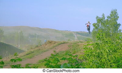 extreme sports motocross motorcycle jumping on a race