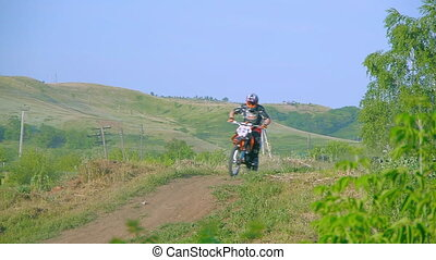 extreme sports motocross motorcycle jumping on a race on high speed