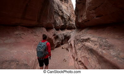 Backpacker Woman inside Slot Canyon - Backpacker Girl...
