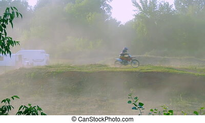 extreme sports motocross motorcycle jumping on a race on...