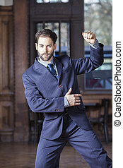 Portrait Of Male Dancer In Suit Performing Argentine Tango -...